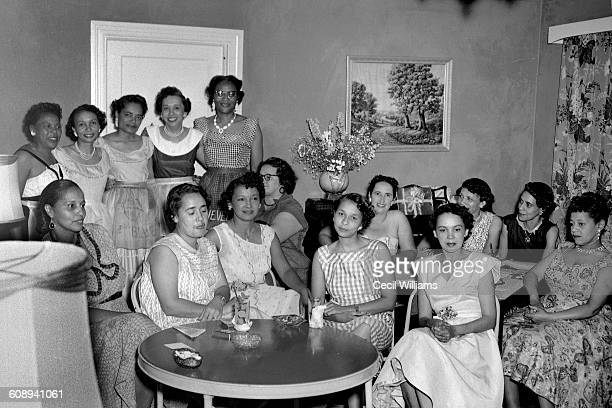 Portrait of an unidentified group of women gathered in the living room of a home Orangeburg South Carolina 1963