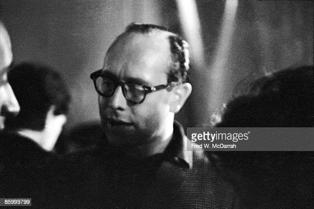 Portrait of an unidentified man as he talks with other guests at a party New York New York April 2 1960