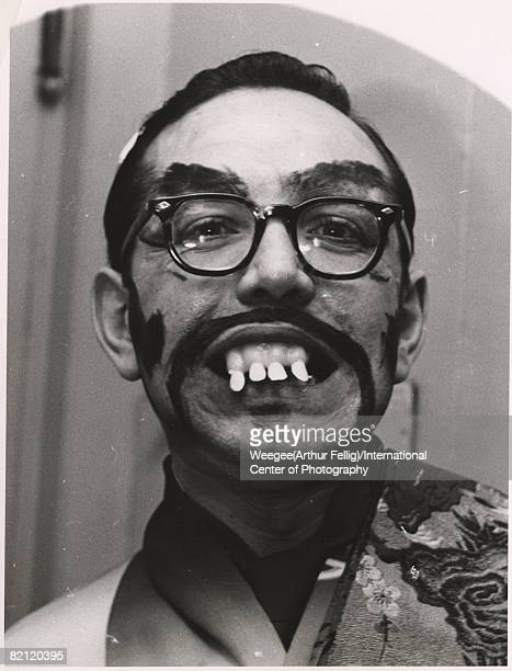 Portrait of an unidentified man in a costume that consists of dark frame glasses fake teeth and drawnon facial hair 1950s Photo by...