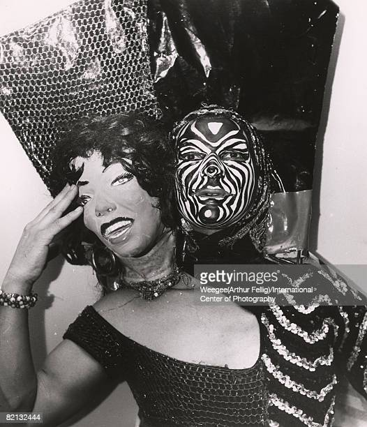 Portrait of an unidentified man in a twoheaded costume that includes a woman's head next to his own painted face mid1950s Photo by...