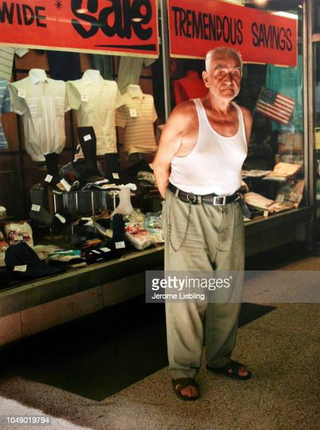 Portrait of an unidentified man in an undershirt as he stands outside a men's clothing store in Brooklyn's Brighton Beach neighborhood New York New...