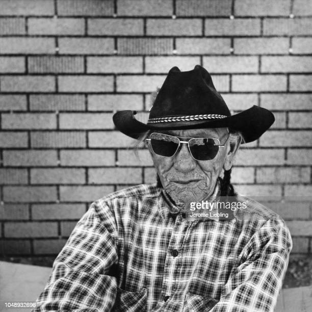 Portrait of an unidentified man on the Blackfeet Indian Reservation Browning Montana 1964 He wears a black cowboy hat and sunglasses