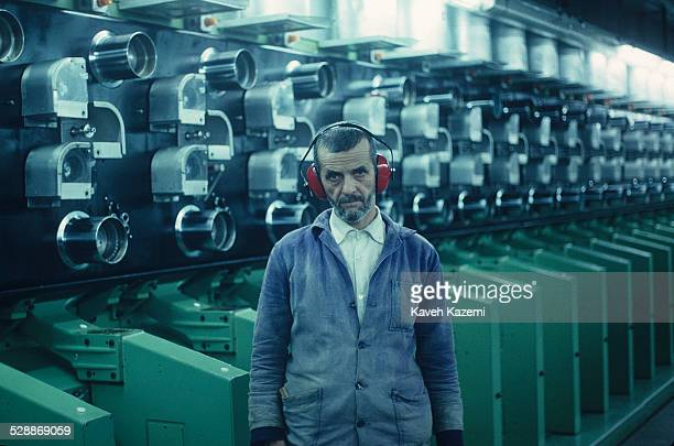 Portrait of an unidentified man on the production floor of a thread factory, Tehran, Iran, February 14, 1989.