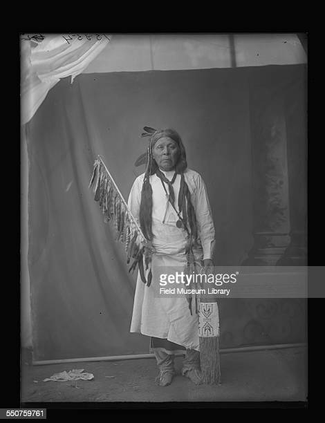 Portrait of an unidentified Native American Wichita man holding a feathered artifact at the Louisiana Purchase Exposition St Louis Missouri June 6...