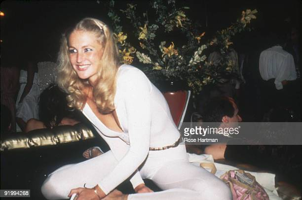 Portrait of an unidentified partygoer as she sits on a raised platform at the nightclub Studio 54 New York New York late 1970s or early 1980s She is...