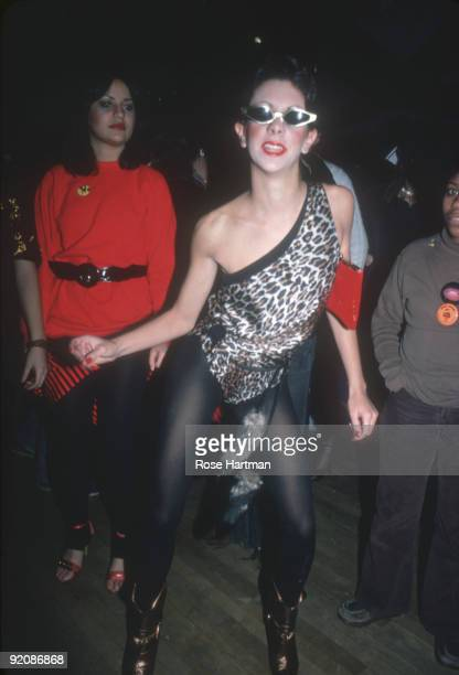 Portrait of an unidentified partygoer dressed in boots black tights a sleeveless leopardprint single shoulder top and sunglasses at the nightclub...