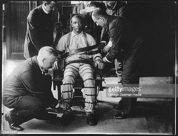 Portrait of an unidentified prisoner as he is strapped into an electric chair at Sing Sing Correctional Facility prior to his execution Ossining New...
