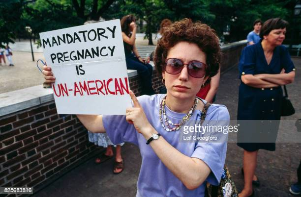 Portrait of an unidentified prochoice counterdemonstrator at the annual antiabortion March for Life Washington DC April 5 1992 She holds a sign that...