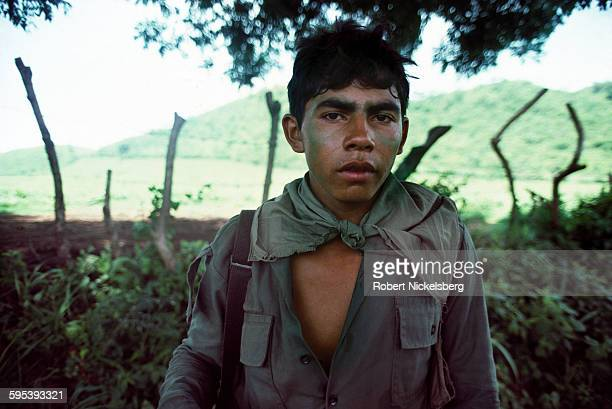Portrait of an unidentified Salvadoran soldier of the Atlacatl Battalion as he stands in the shade during an operation in San Miguel province El...