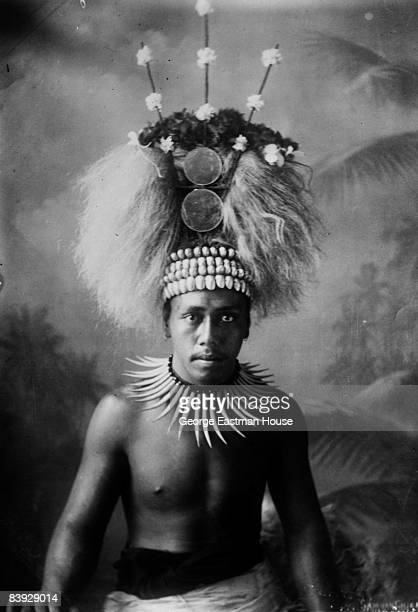 A portrait of an unidentified Samoan chief dressed in ceremonial headdress and necklace ca1910s Unspecified location