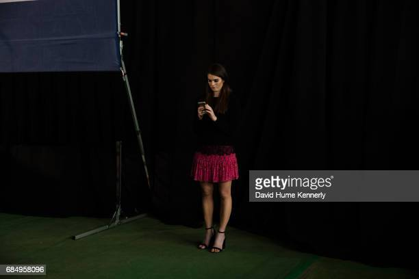Portrait of an unidentified woman as she looks at her smartphone during Donald Trump's campaign rally at the Norris Penrose Equestrian Center...