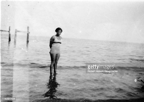 Portrait of an unidentified woman as she poses in the water near the shore of Idlewild Lake Idlewild Michigan September 1938 Idlewild known as 'the...