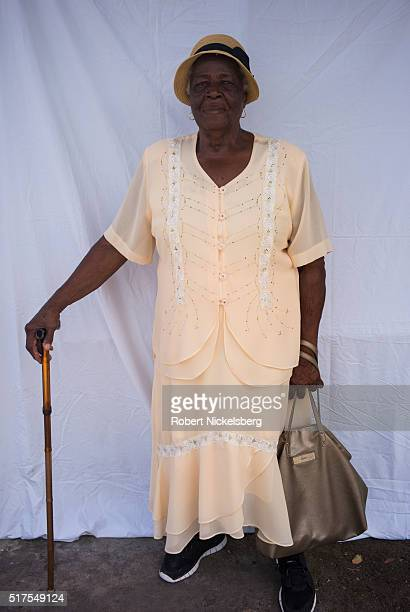 Portrait of an unidentified woman in a peachcolored outfit as she poses in front of a white backdrop Hillsborough Carriacou island Grenada March 7...