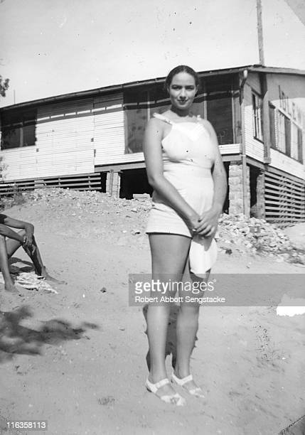 Portrait of an unidentified women as she poses on the beach outside the Idlewild Club House Idlewild Michigan September 1938 Idlewild known as 'the...