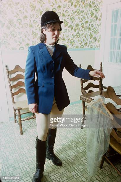 Portrait of an unidentified young woman in equestrian clothing as she stands in Harry de Leyer's Long Island farm Smithtown New York 1976 De Leyer...