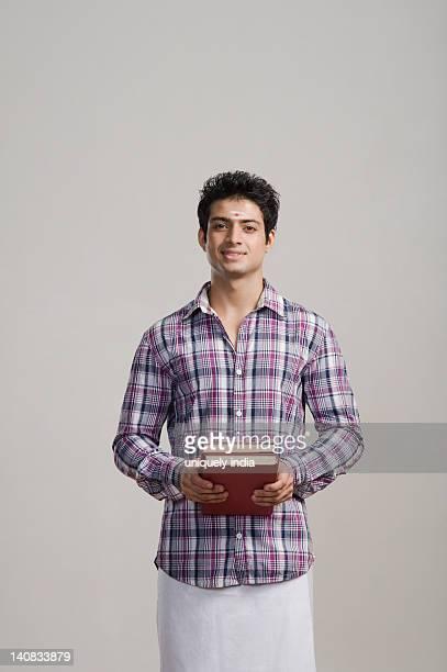 Portrait of an university student holding books