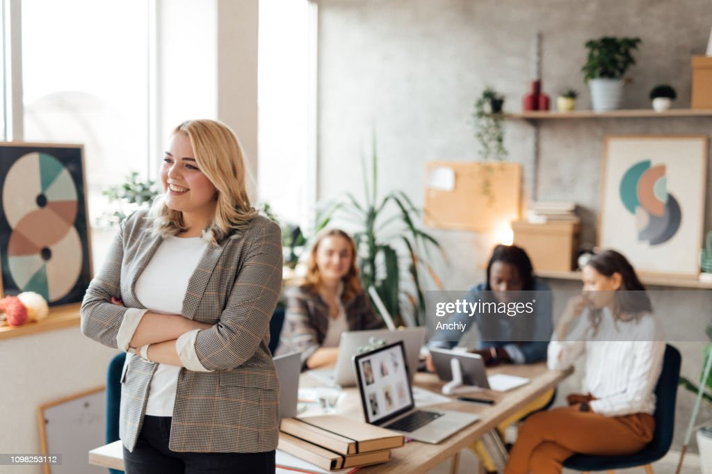 Portrait of an young confident businesswoman : Stock Photo