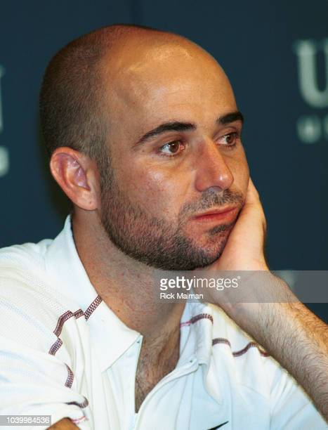 Portrait of Andre Agassi as he responds to questions from the press after his loss to Arnaud Clement