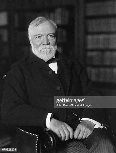 portrait of andrew carnegie seated in a library. - andrew carnegie stock pictures, royalty-free photos & images