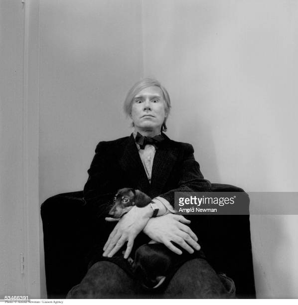 Portrait of Andy Warhol American Pop artist with his dog at his studio February 2 1973 in New York City