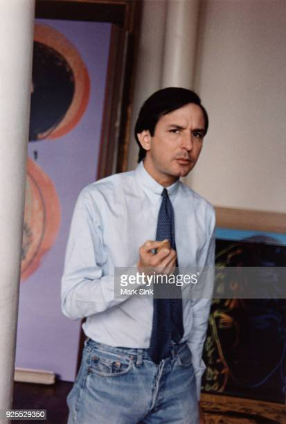 Portrait of Andy Warhol's business manager Frederick Hughes eats on the go at The Factory September 13 1981 at 860 Broadway New York City New York