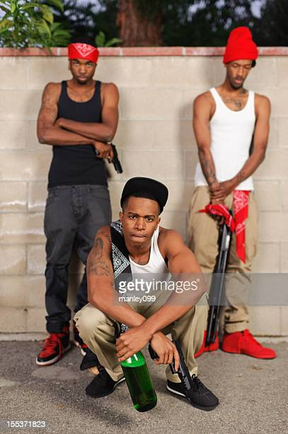 portrait of angry gang bangers - black alley stock photos and pictures