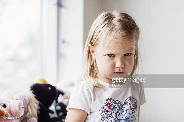 portrait of angry little girl at classroom - reizen stock-fotos und bilder