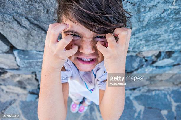 portrait of angry little girl - tantrum stock photos and pictures