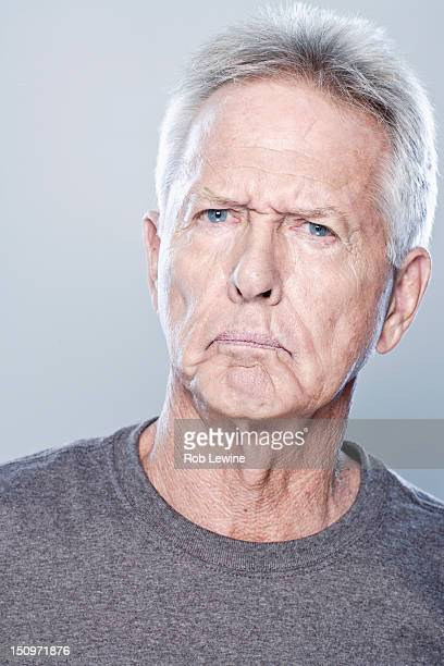 Portrait of angry senior man, studio shot