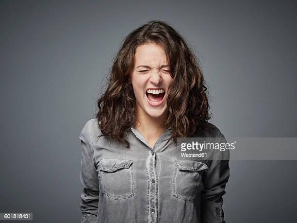 Portrait of angry teenage girl