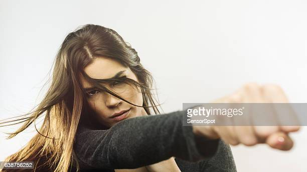 Portrait of angry woman punching the air
