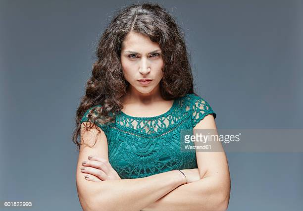 Portrait of angry young woman with crossed arms