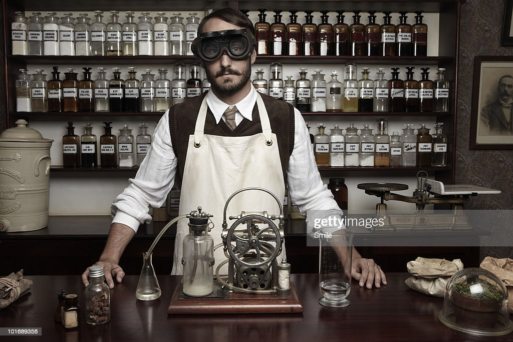Portrait of antiquated chemist with goggles : Stock Photo