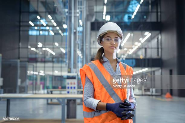 portrait of apprentice in workshop of railway engineering facility - reflective clothing stock pictures, royalty-free photos & images