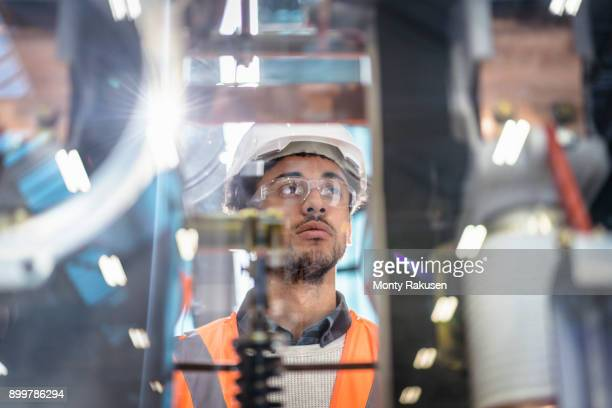 Portrait of apprentice in workshop of railway engineering facility