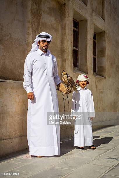Portrait of Arab man and son with falcon