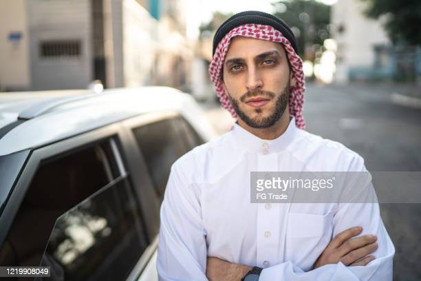 portrait of arab middle east man at street - qatar stock pictures, royalty-free photos & images