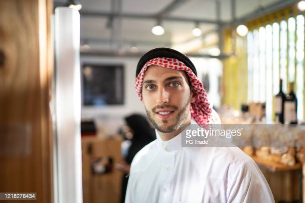 portrait of arab middle east man customer at convenience store - loyalty stock pictures, royalty-free photos & images