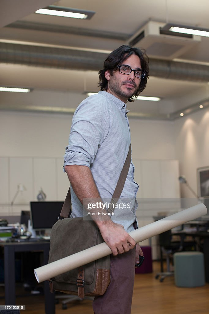 Portrait of architect holding blueprint tube in office stock photo portrait of architect holding blueprint tube in office stock photo malvernweather Image collections