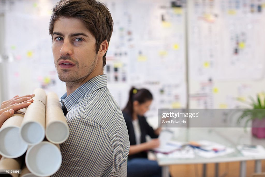 Portrait of architect holding blueprint tubes in office stock photo portrait of architect holding blueprint tubes in office stock photo malvernweather Image collections