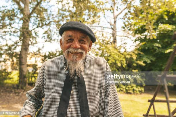 portrait of argentinian senior man in the farm - humility stock pictures, royalty-free photos & images