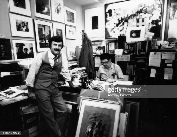 Portrait of art dealer and gallery owner Lee Witkin as he stands in his office at the Witkin Gallery, New York, New York, 1978. The man at right is...