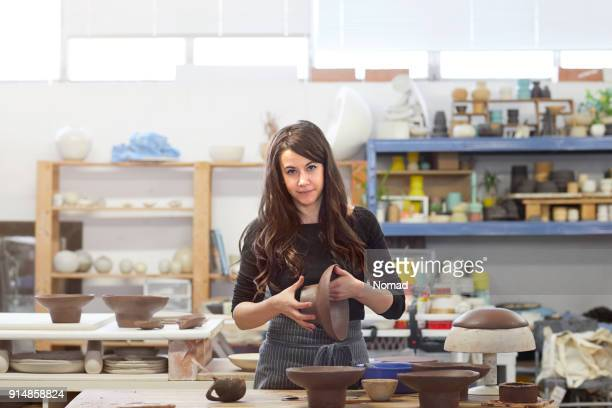 portrait of artist making pottery at workshop - potter stock pictures, royalty-free photos & images