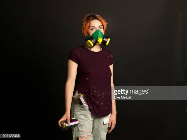 portrait of artist wearing a protective mask - street artist stock photos and pictures