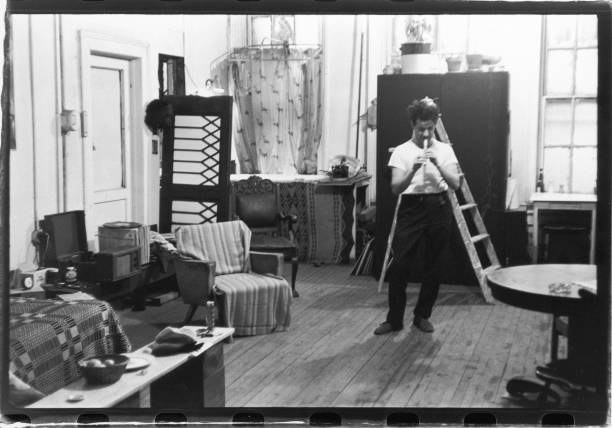 Portrait of arts critic Leonard Horowitz as he plays...