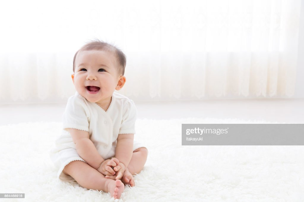 portrait of asian baby in living room : Stock Photo