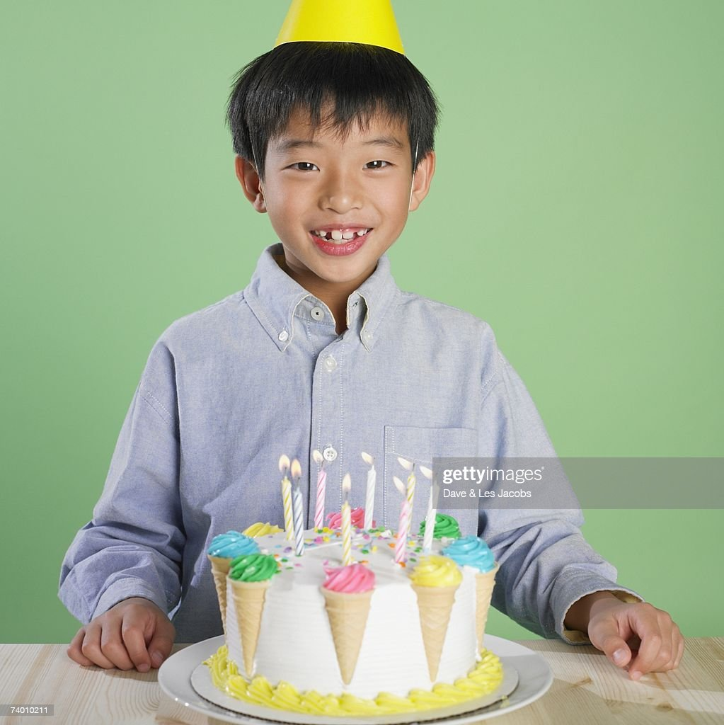Portrait Of Asian Boy With Birthday Cake Stock Photo Getty Images