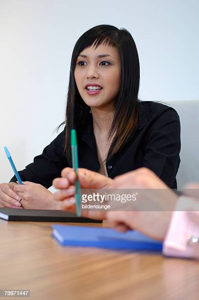 portrait of Asian businesswoman in discussion in meeting
