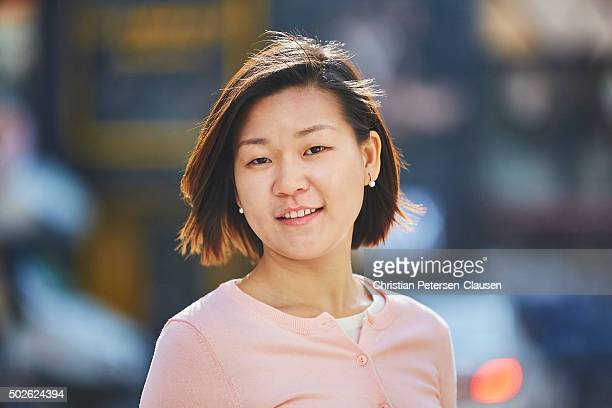 Portrait of Asian businesswoman looking at camera