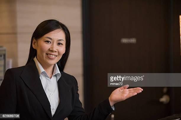 Portrait of Asian Concierge in Hotel